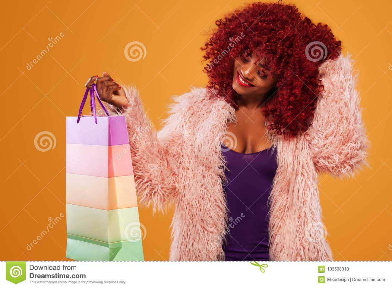 d3e89afc Beautiful young woman make shopping in black friday holiday. Girl with bag  on lgiht background.