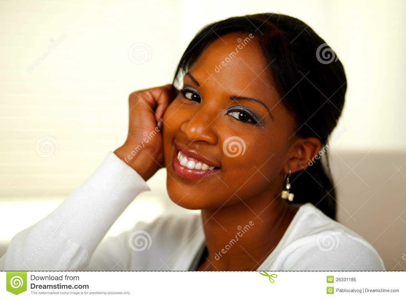 Afro-american young woman smiling at you