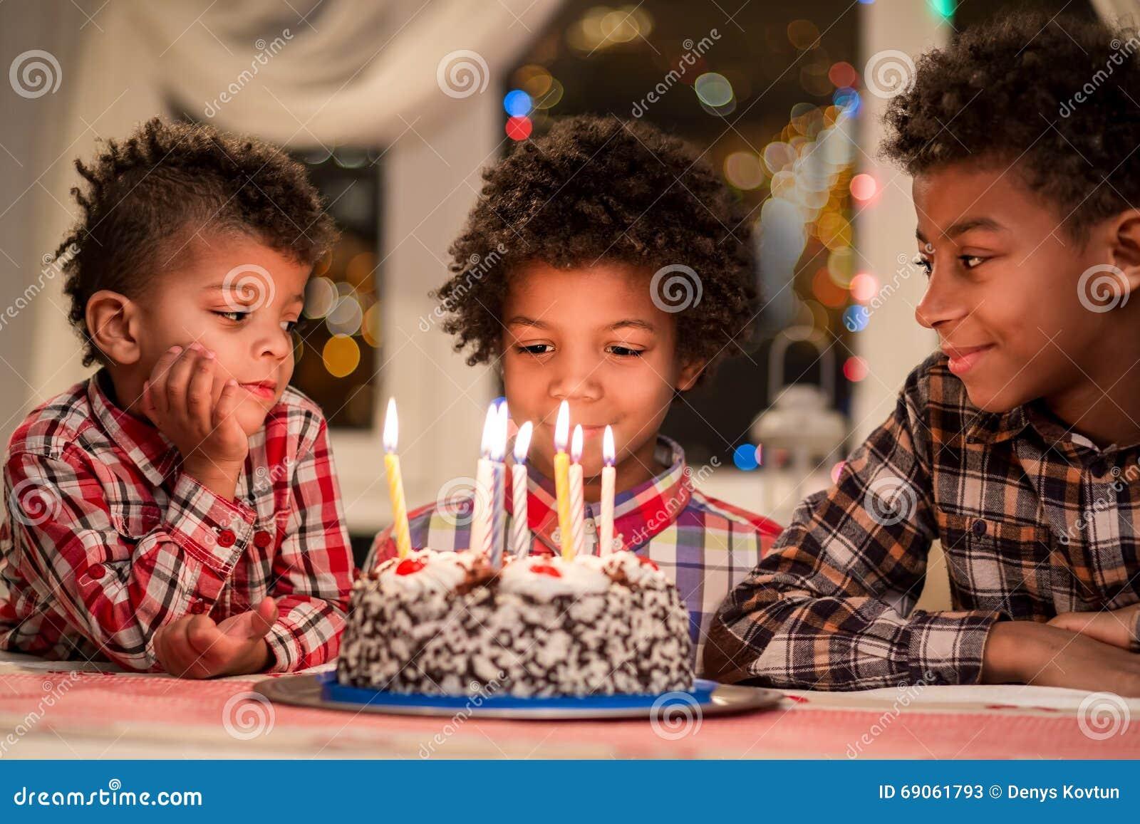 Afro boys and birthday cake.