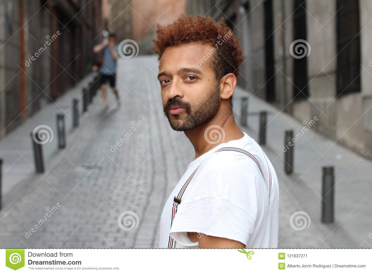 Afro man with neutral expression outdoors