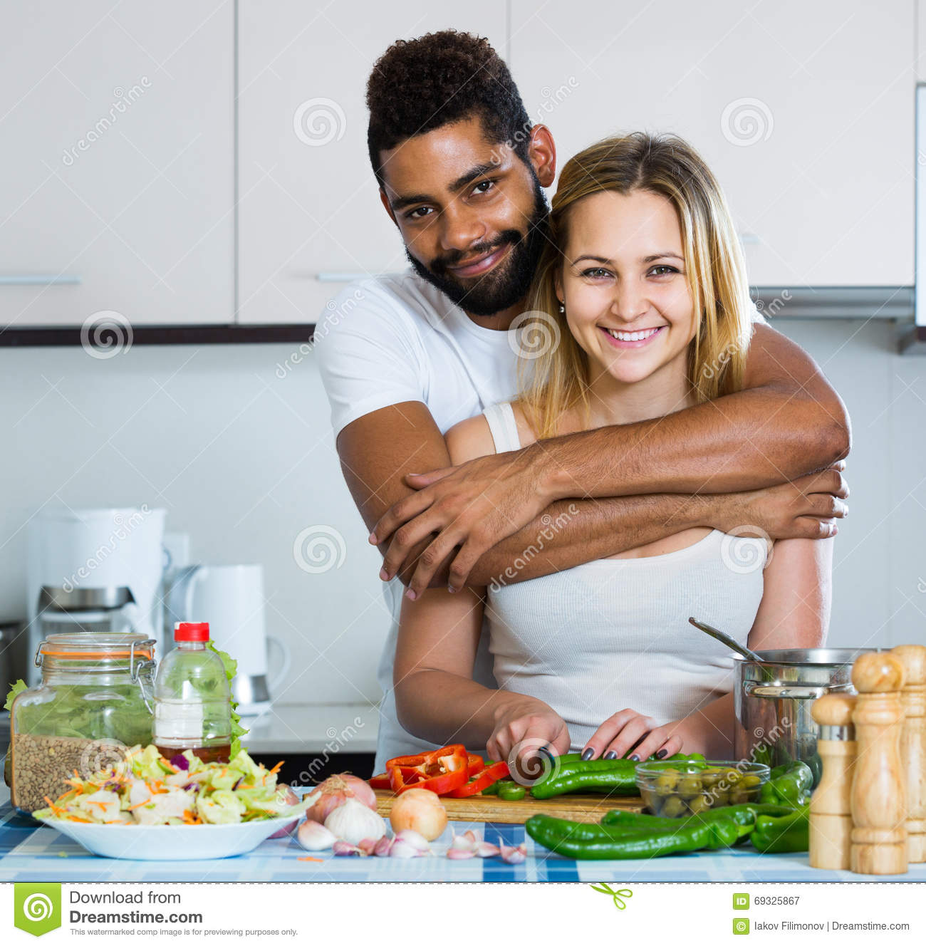 Afro Man And White Woman Cooking At Kitchen Table Stock Image - Image of  person, happy: 69325867