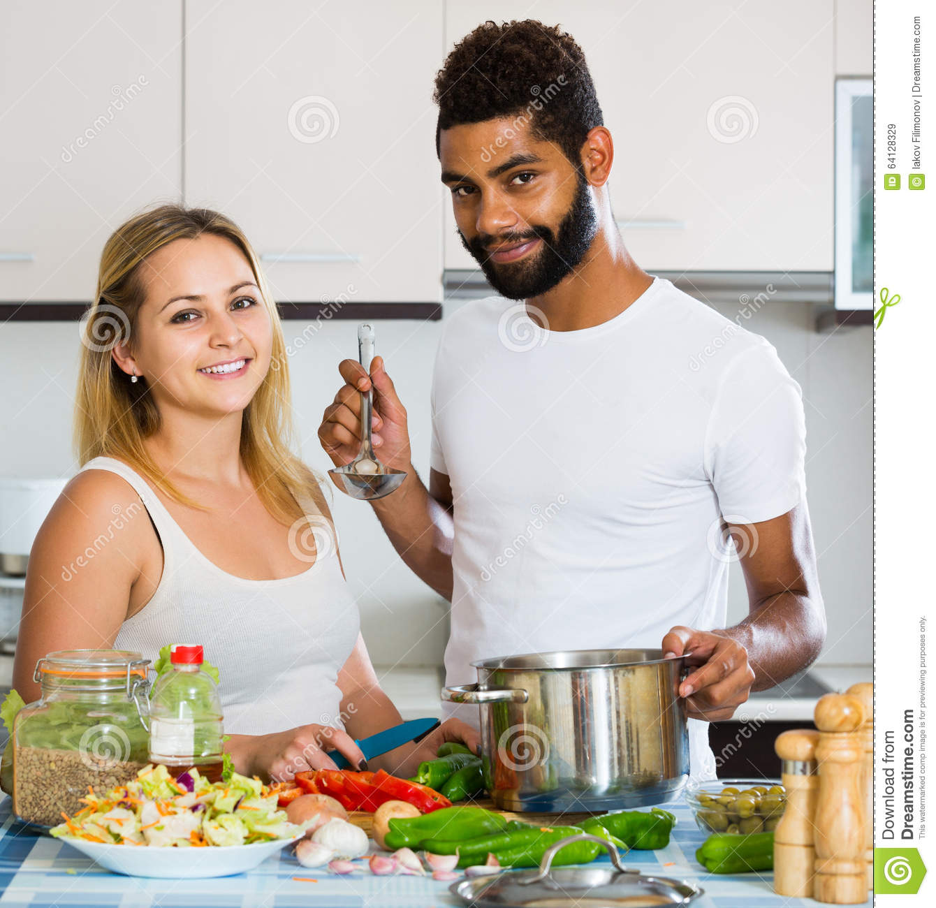 Afro Man And White Woman Cooking At Kitchen Table Stock Image ...