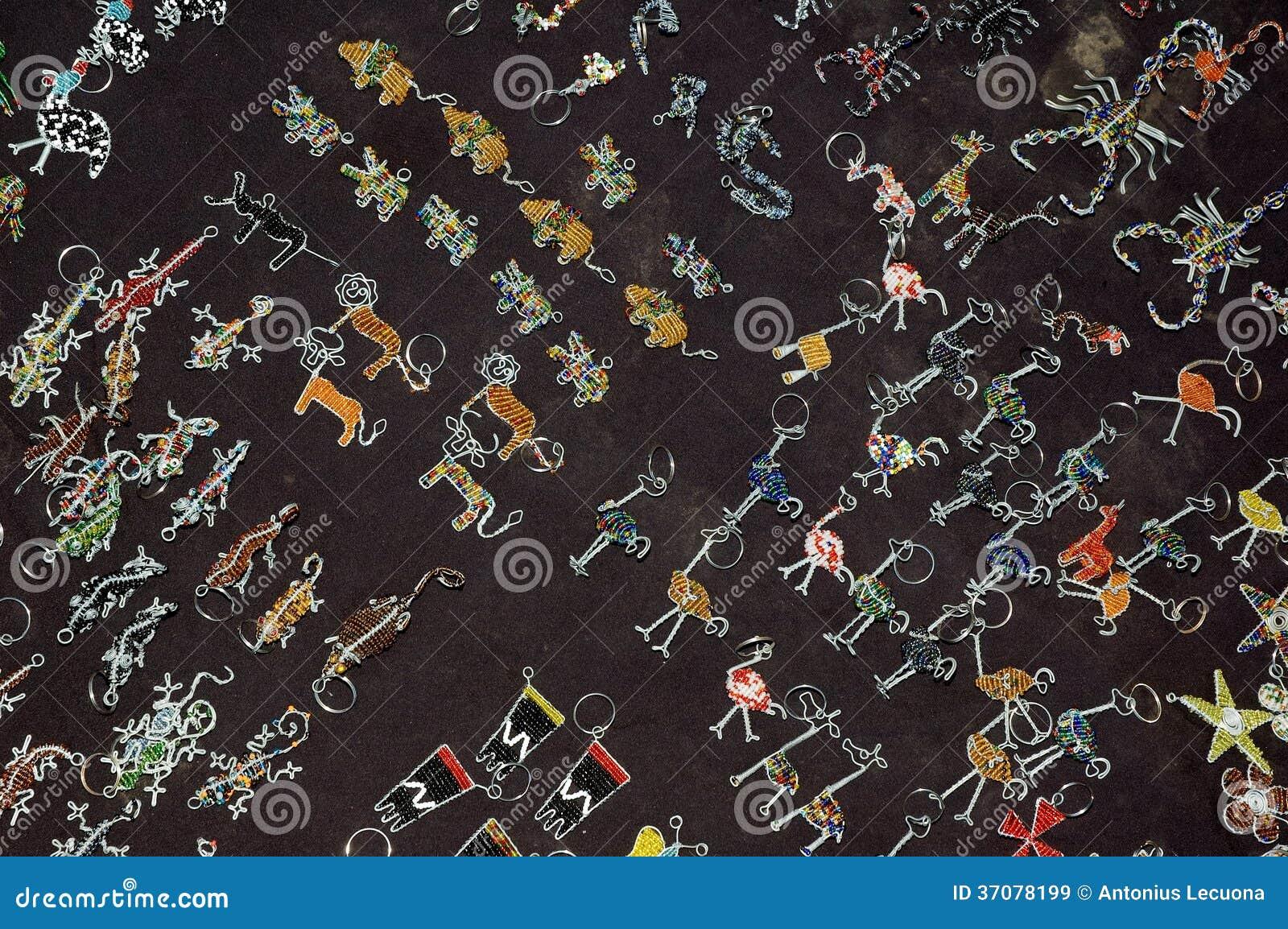 Download Afrykańskiej Sztuki Kluczowi Pierścionki Obraz Stock - Obraz złożonej z zwierzęta, czerwień: 37078199