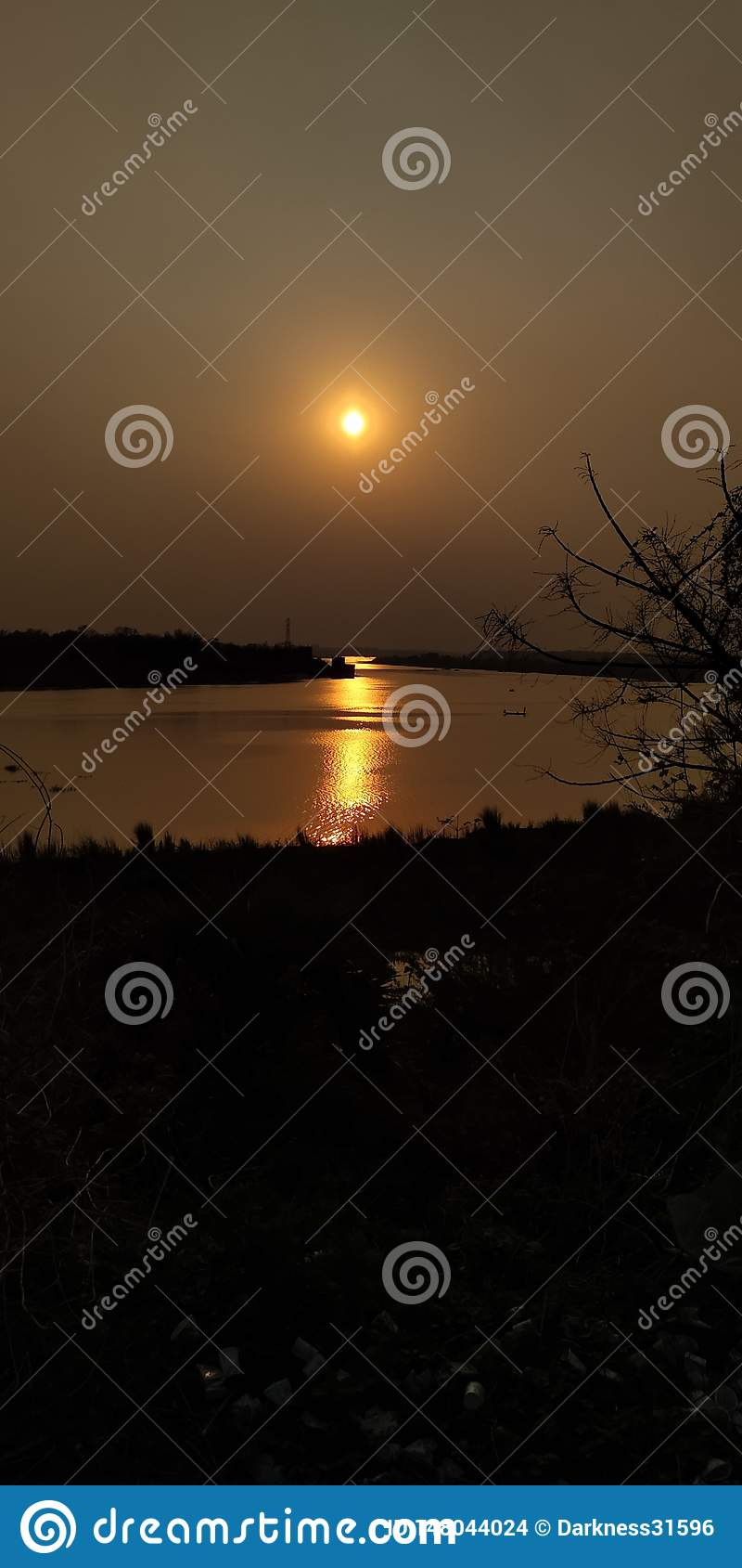 Afternoon, beside the river, sunset, relfect sunrays in water