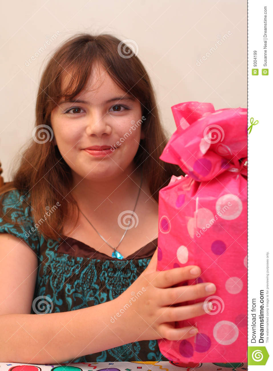 A Birthday For Pretty Smiling 13 Year Old Teen Who Is Holding Gift Or Present Model Multicultural Asian And Caucasian With Brown Hair Eyes