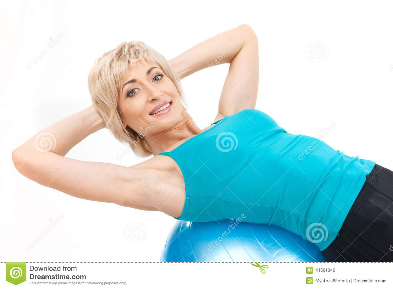 Aged blond woman on fitness ball stock photo image for Lady fitness