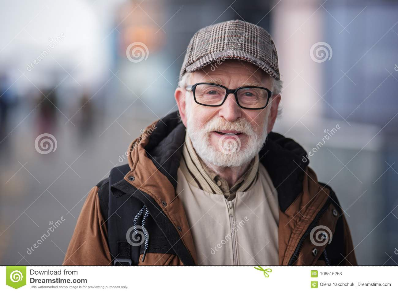 Aged gray-haired male is expressing gladness