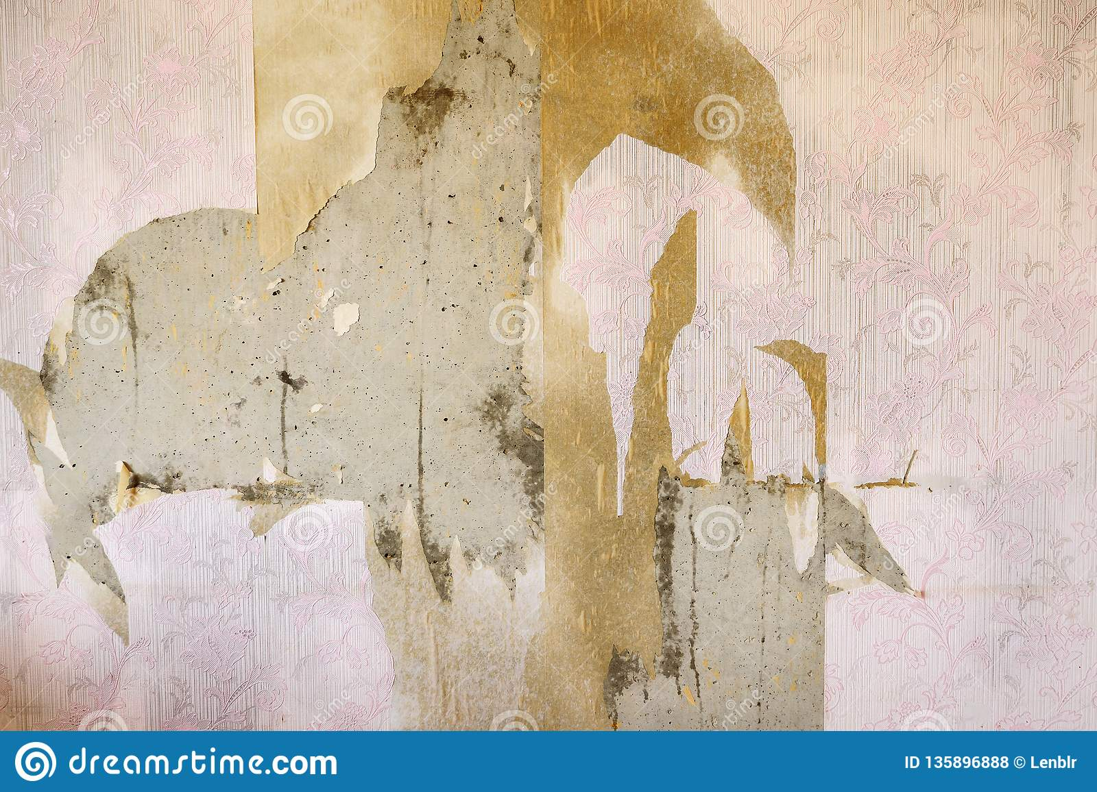 Aged room wall background with torn vintage wallpaper