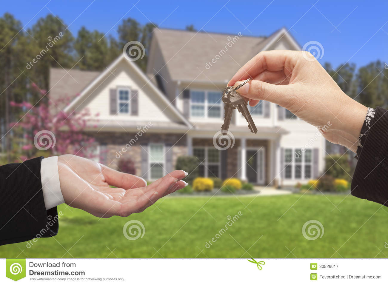 Agent handing over the house keys in front of new home for Modern house estate agents