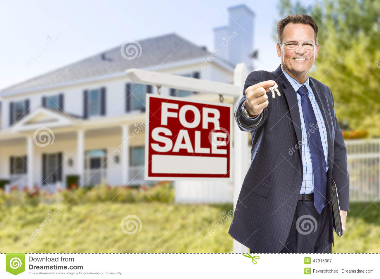 Real Estate Agent Holding Sold Sign Outside House Stock