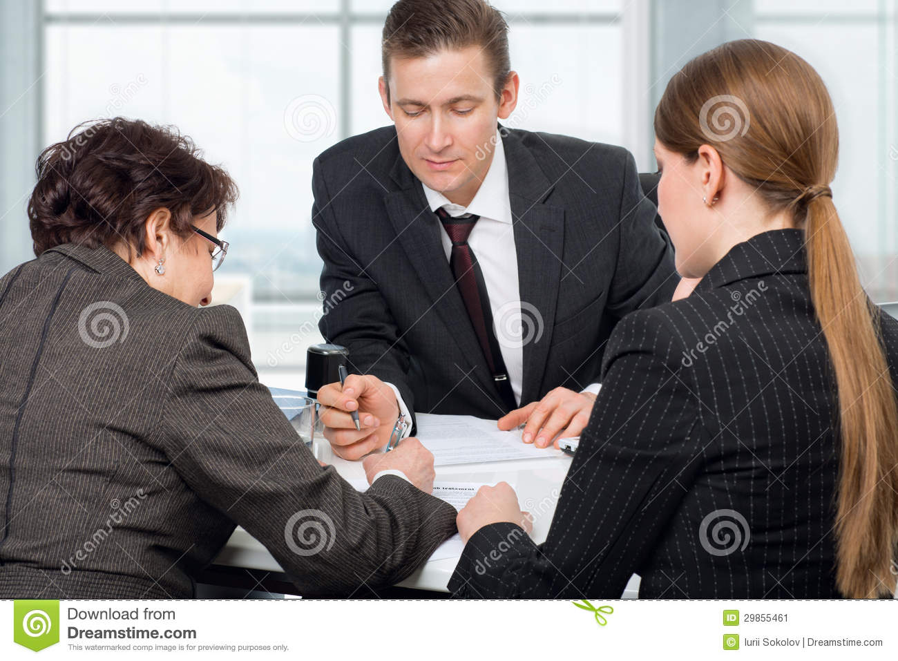 Agent Signing Documents With Couple Women Stock