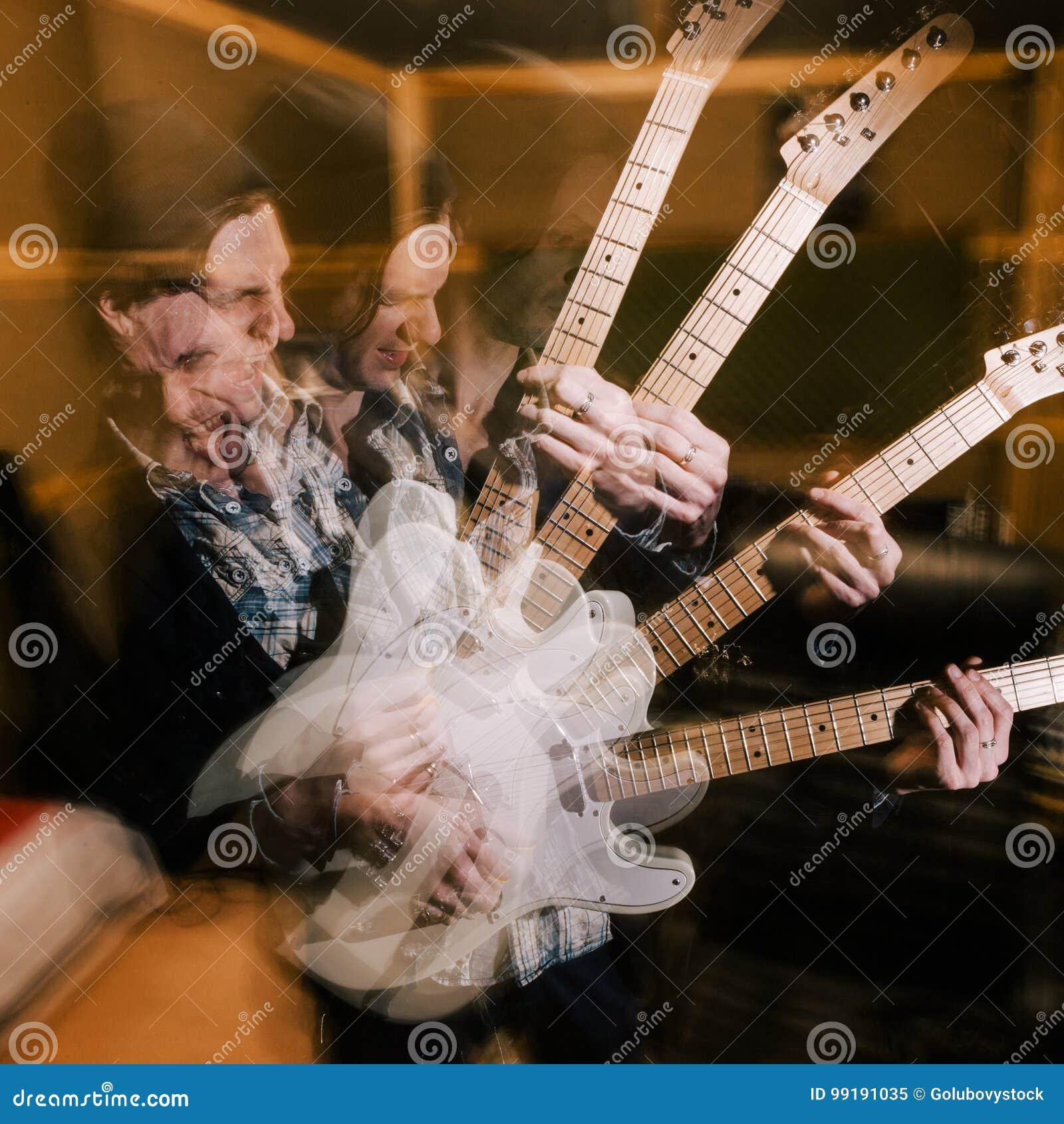 Aggressive heavy music. Male guitarist portrait