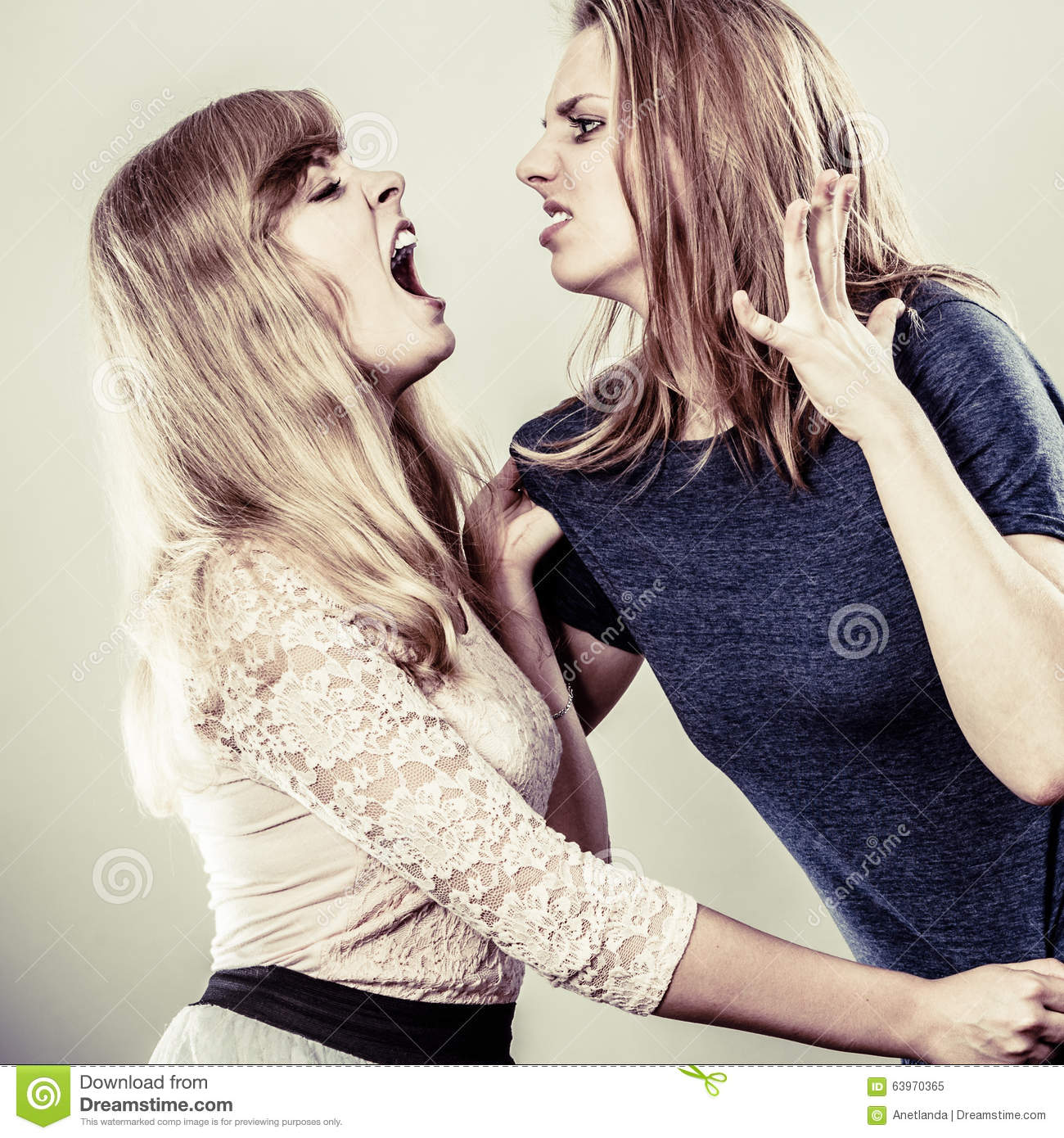 Aggressive Mad Women Fighting Each Other. Stock Photo