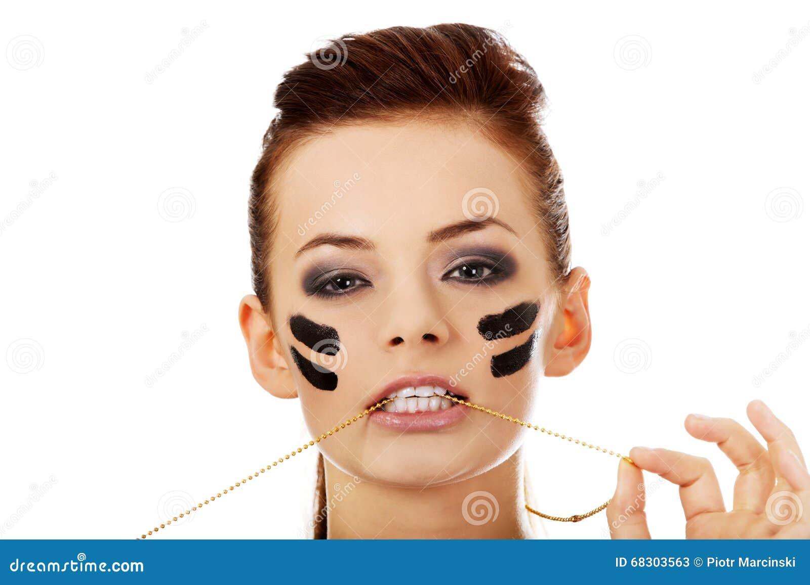 Aggressive military woman bites a military dog tag