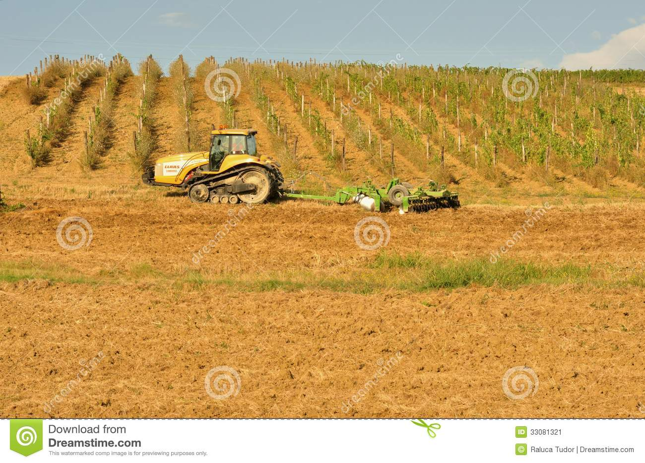 Agriculture In Italy With A Tractor On The Fields