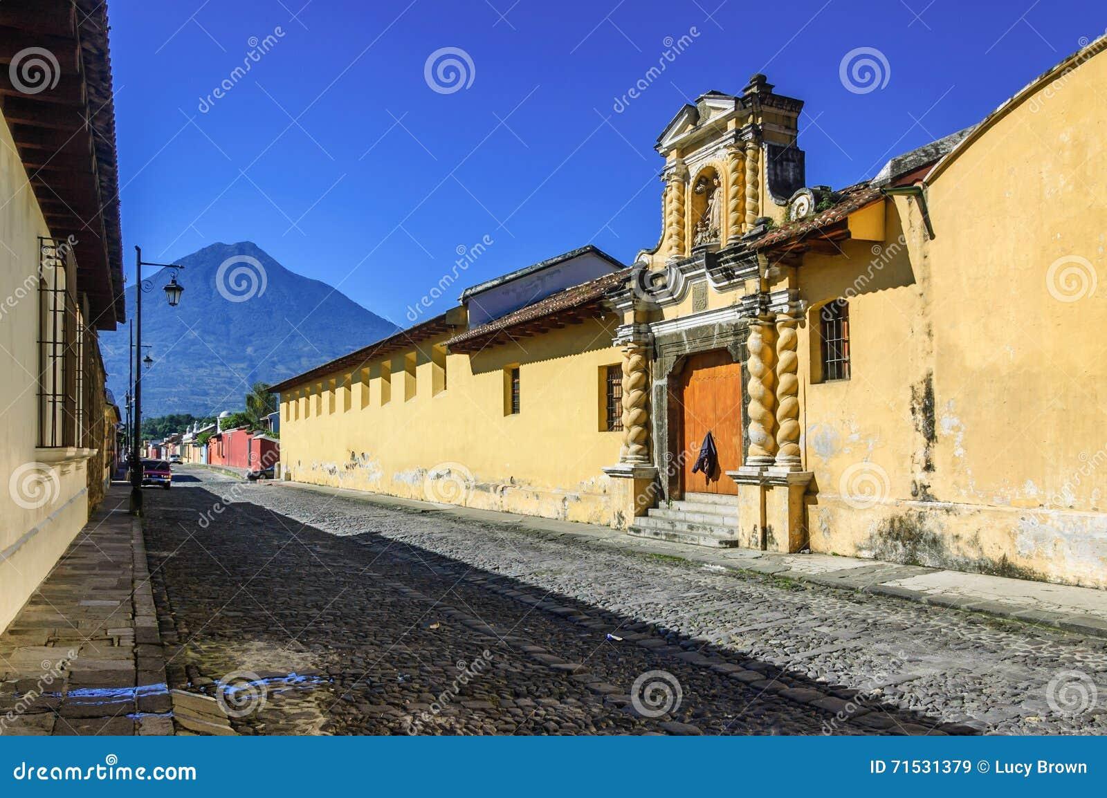 Agua volcano & cobblestone street, Antigua, Guatemala