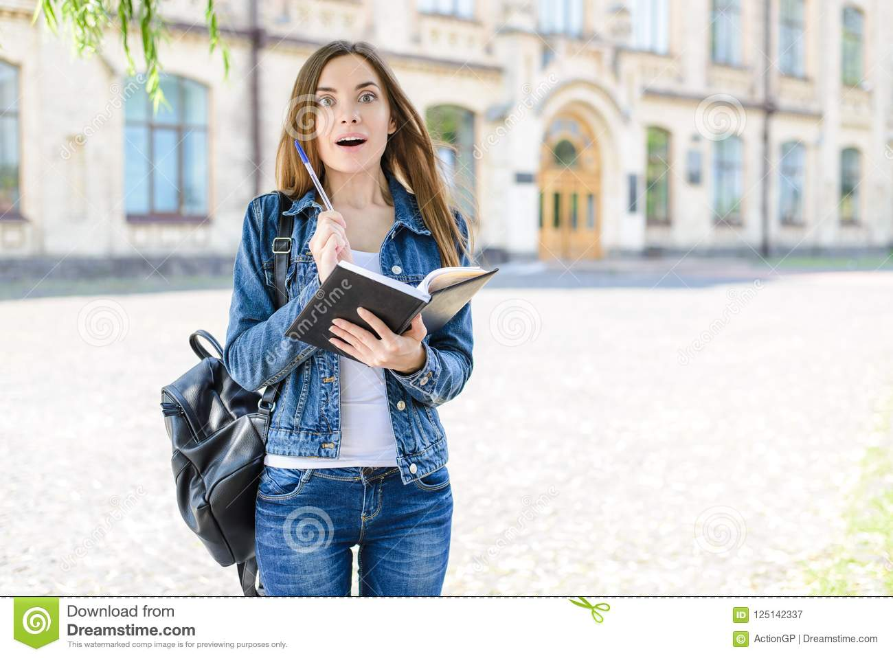 Aha moment! Test answer good emotion novelty people concept. Photo portrait of surprised excited cheerful joyful teenager holding