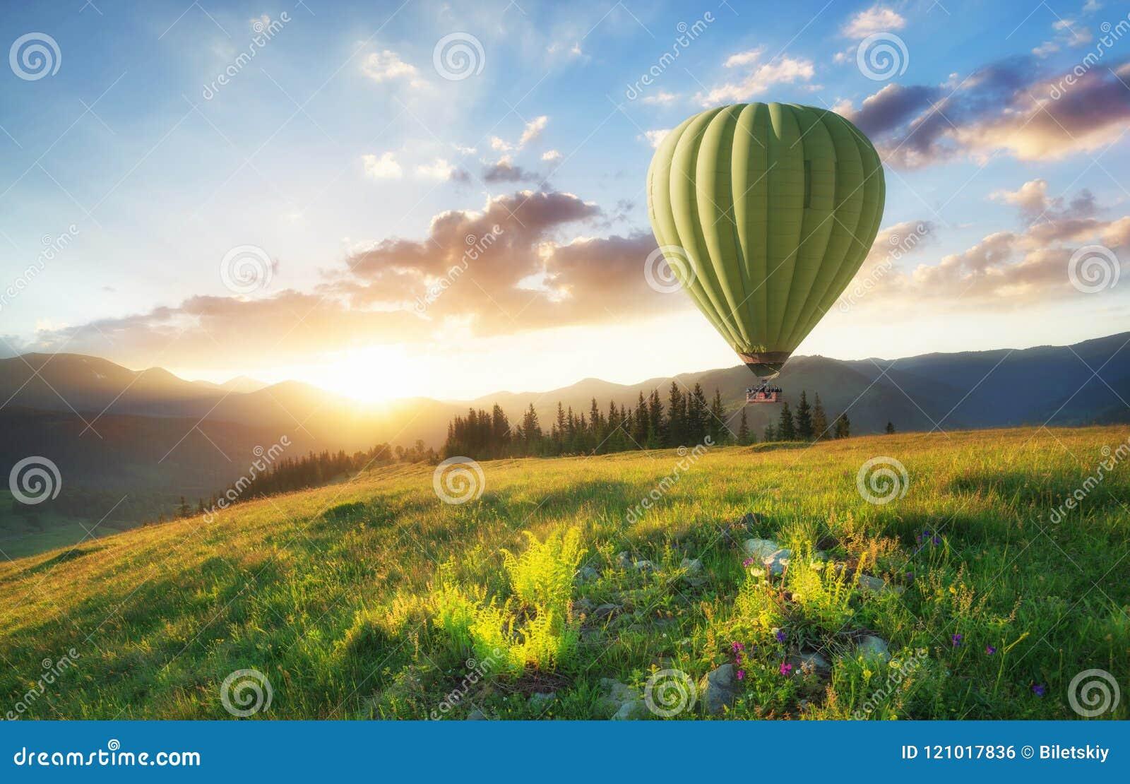 Air ballon above mountains at the summer time.