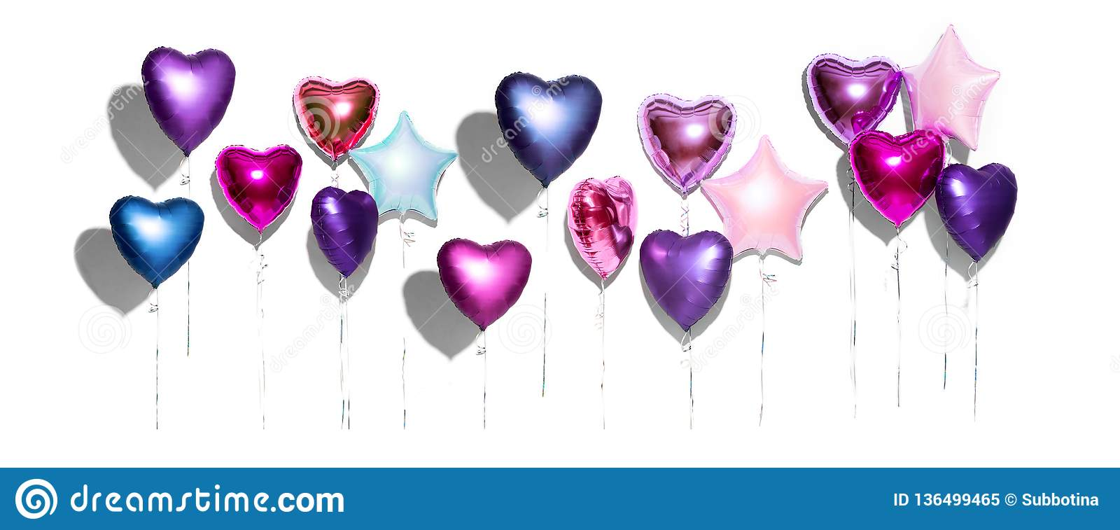 Air balloons. Bunch of purple heart shaped foil balloons, isolated on white background. Valentine`s day