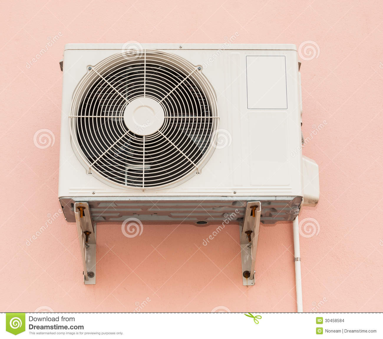 Air Conditioner Compressor Unit On Orange Wall Stock Photo