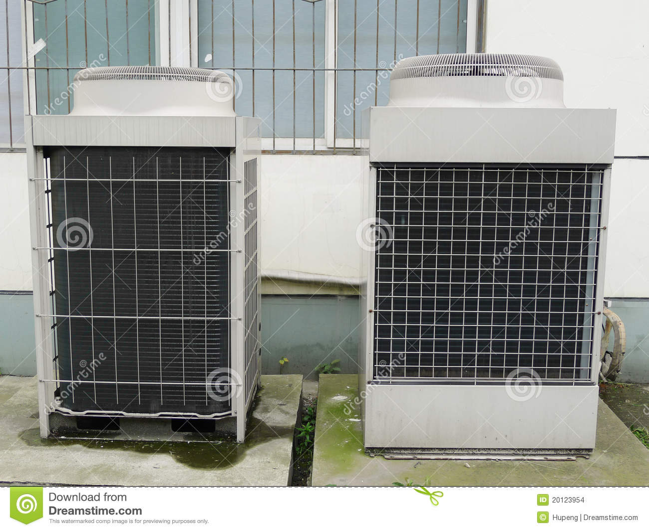 Residential air conditioner condenser unit outside a house. #676B48