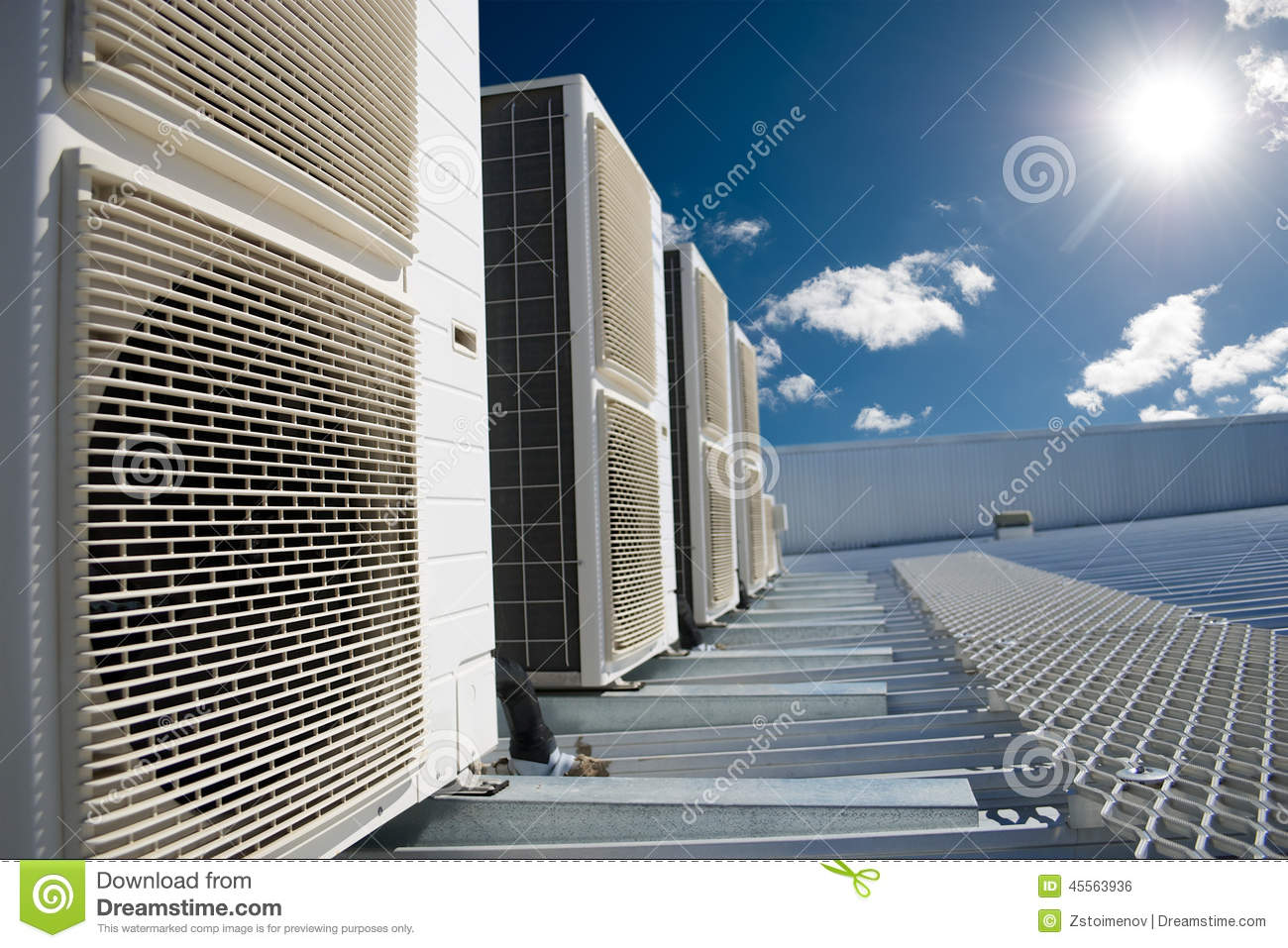 Air Conditioner Units With Sun And Blue Sky Stock Photo