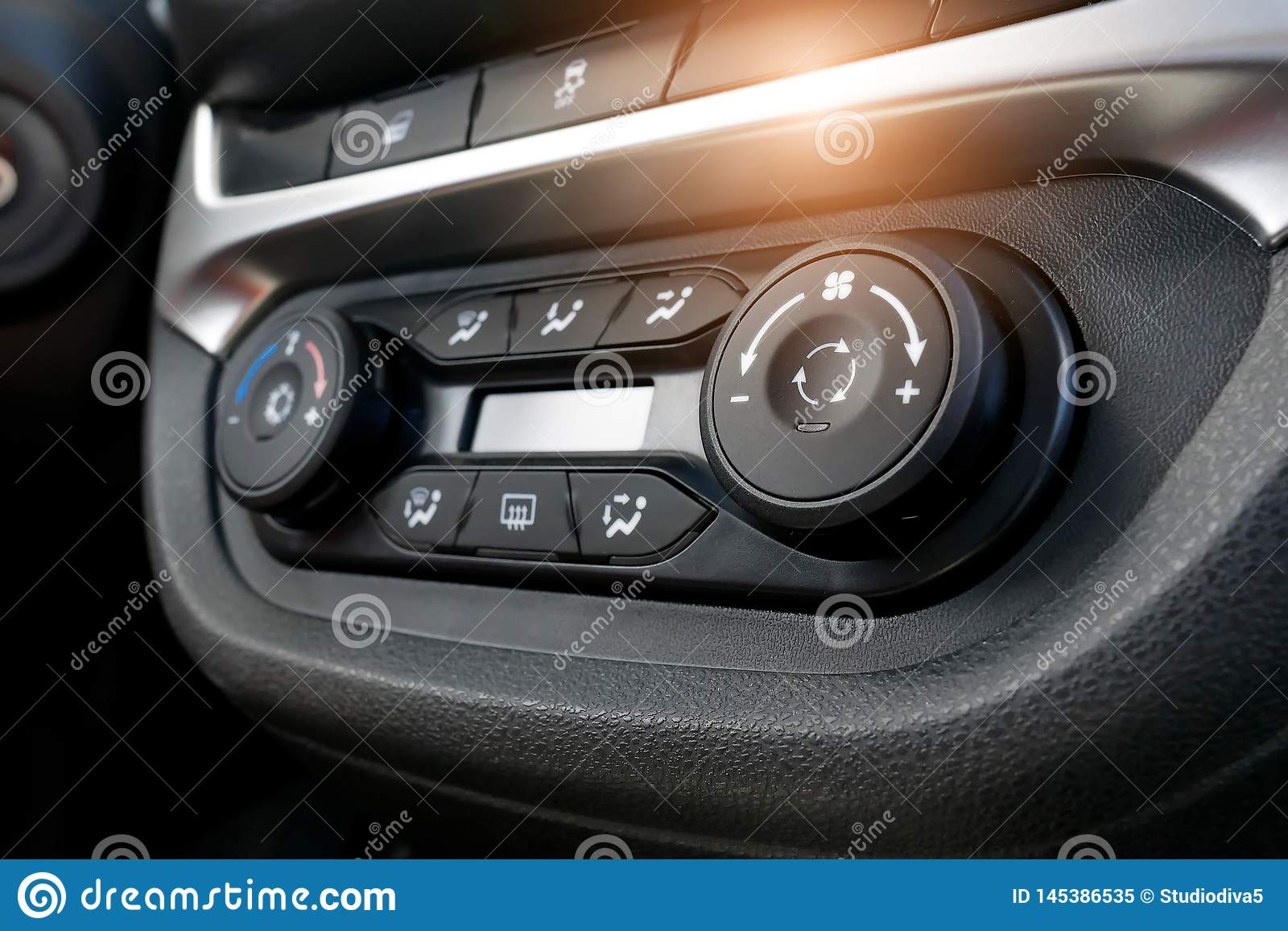 Air conditioning button inside a car. Climate control unit in the new car. Modern car interior details. Car detailing. Selective