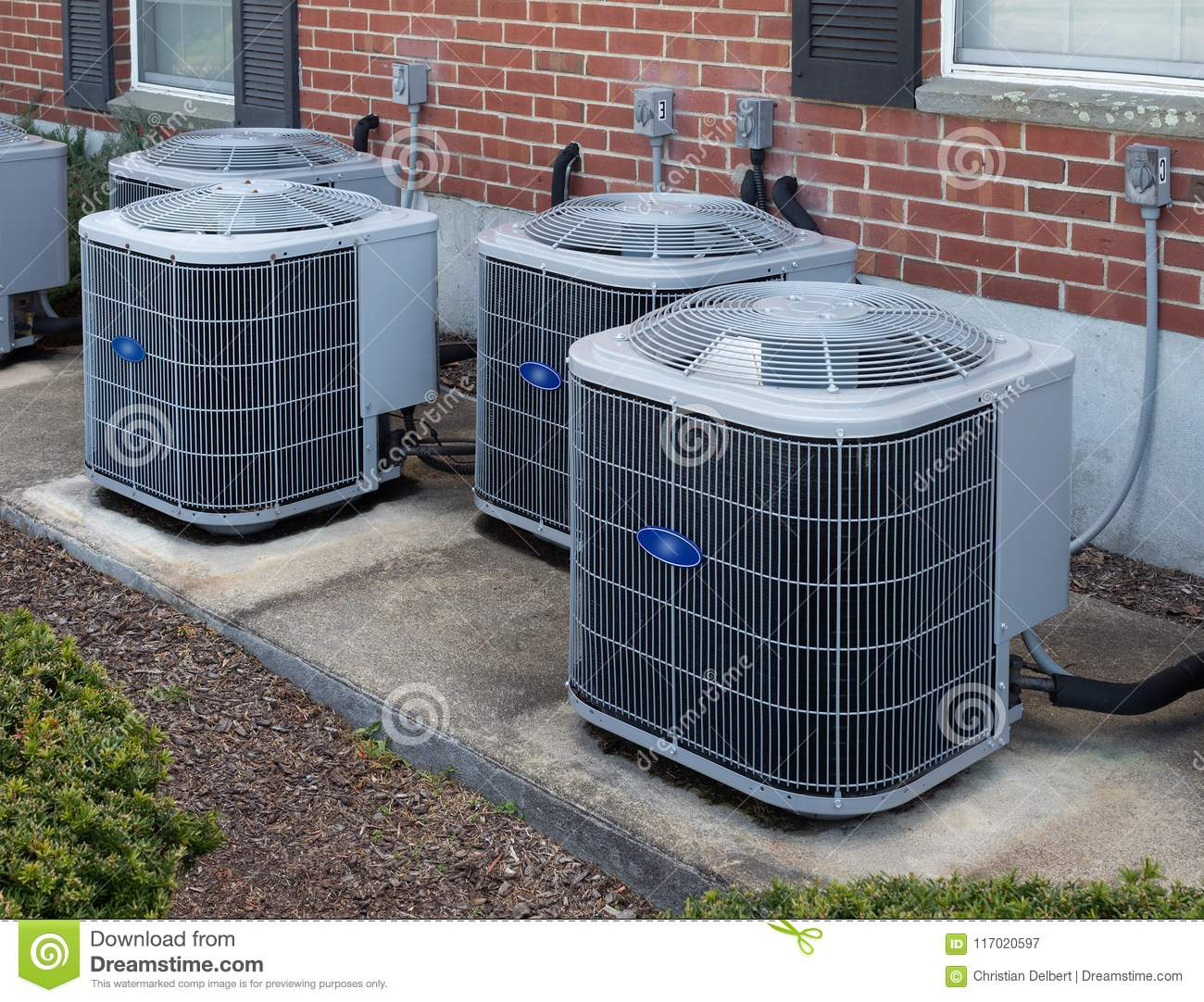 Air Conditioning Units Outside An Apartment Complex Stock
