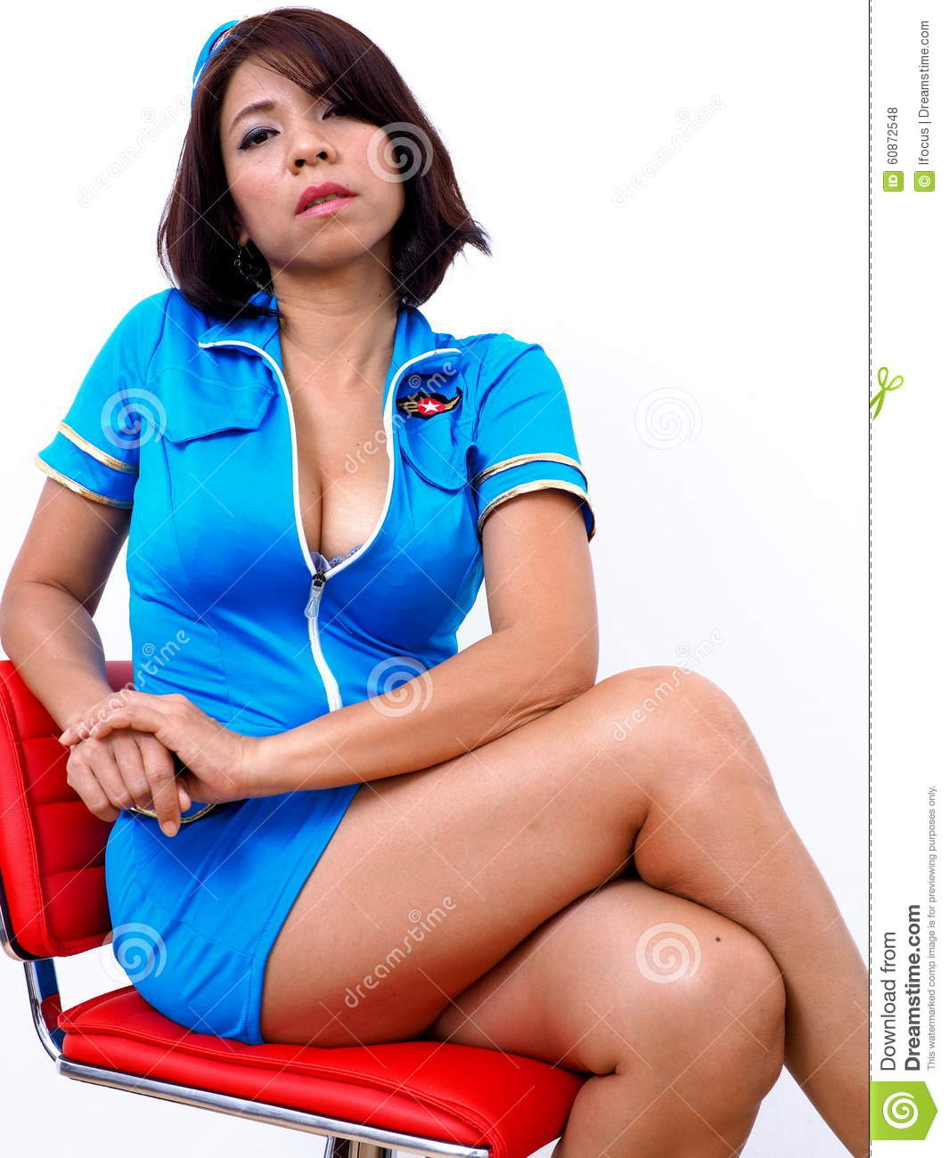 Air Hostess Sits On Red Chair Royalty Free Stock Image