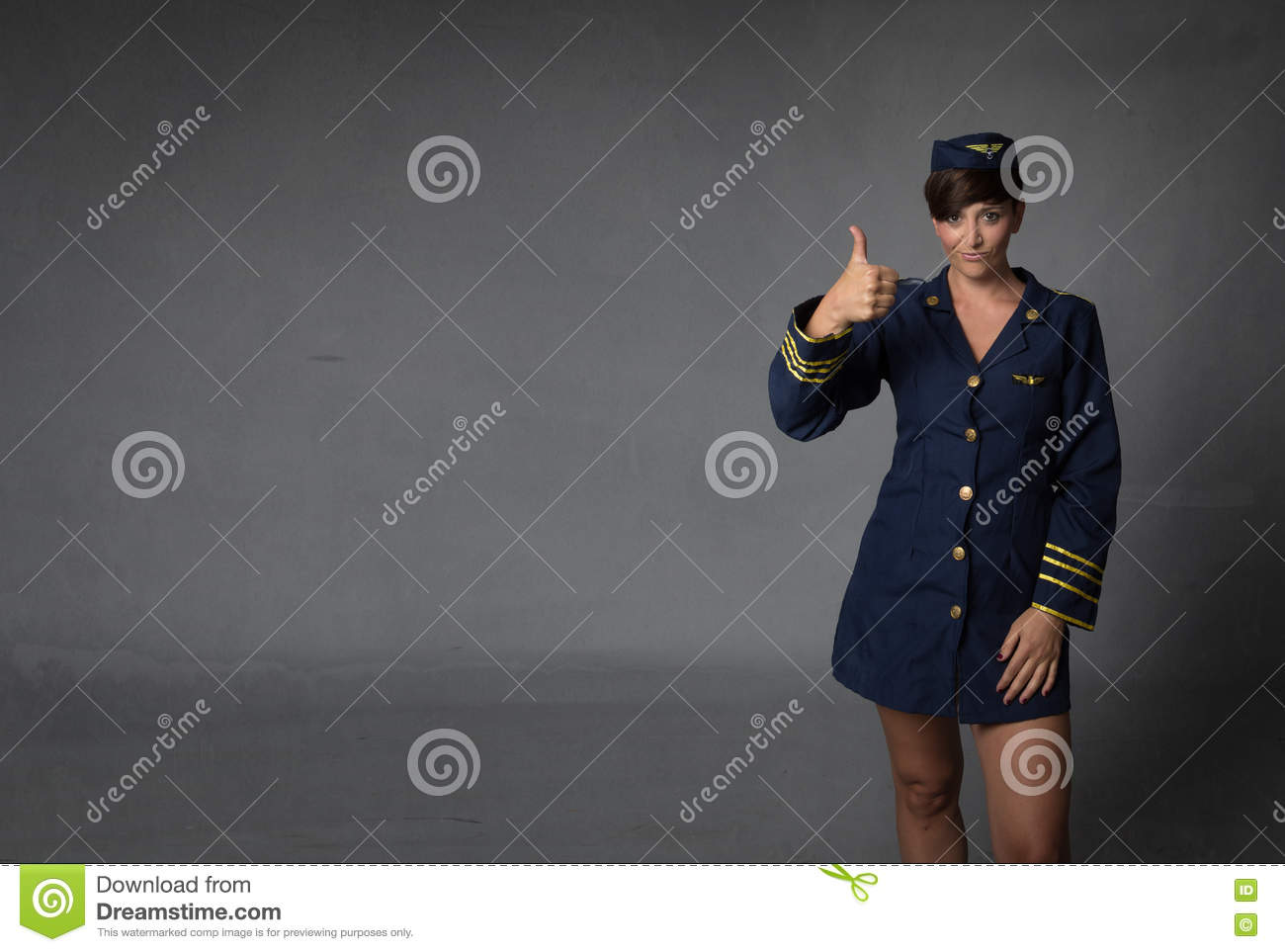 Air hostess thumbing up