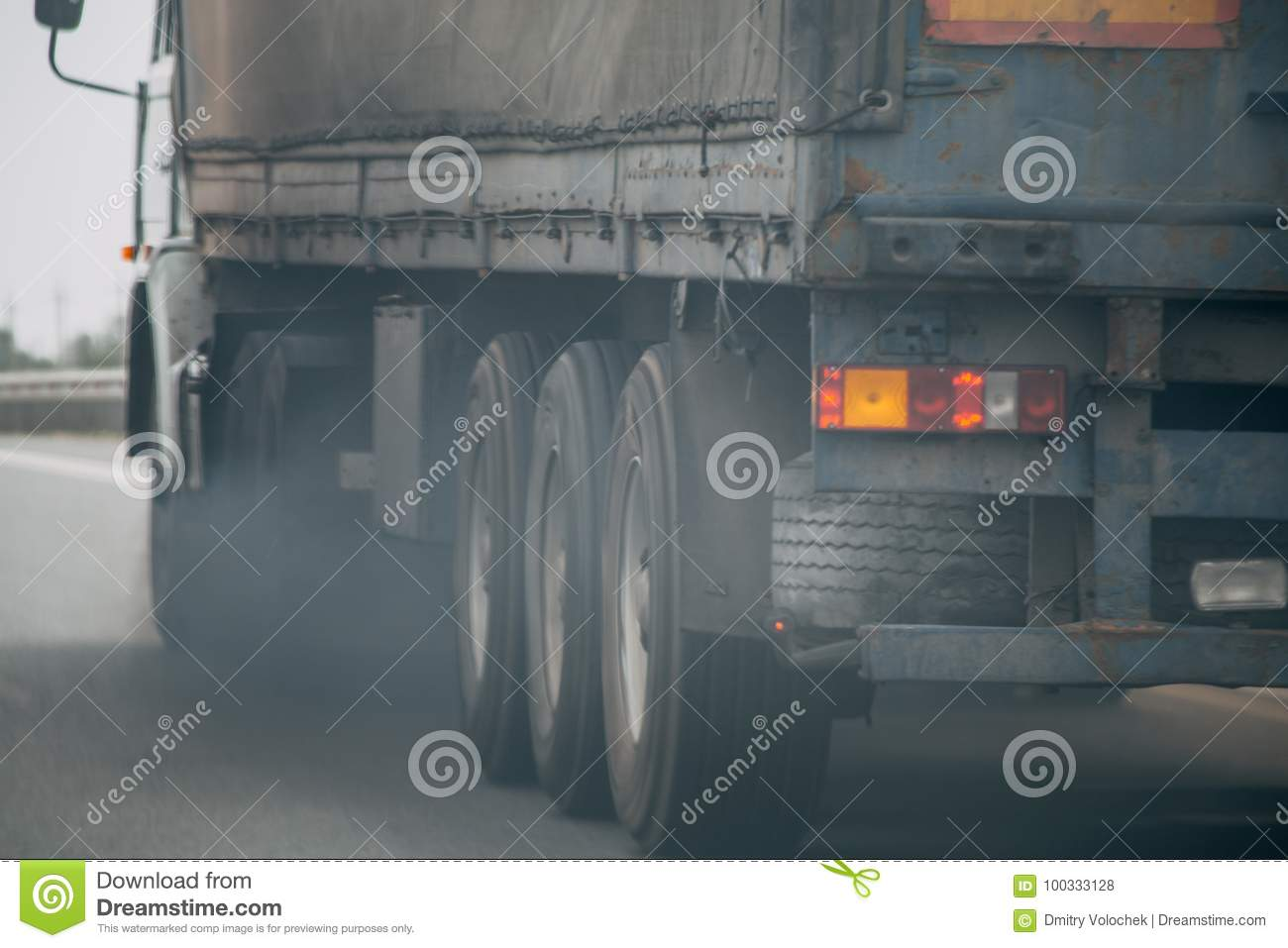 Air pollution from truck vehicle exhaust pipe on road