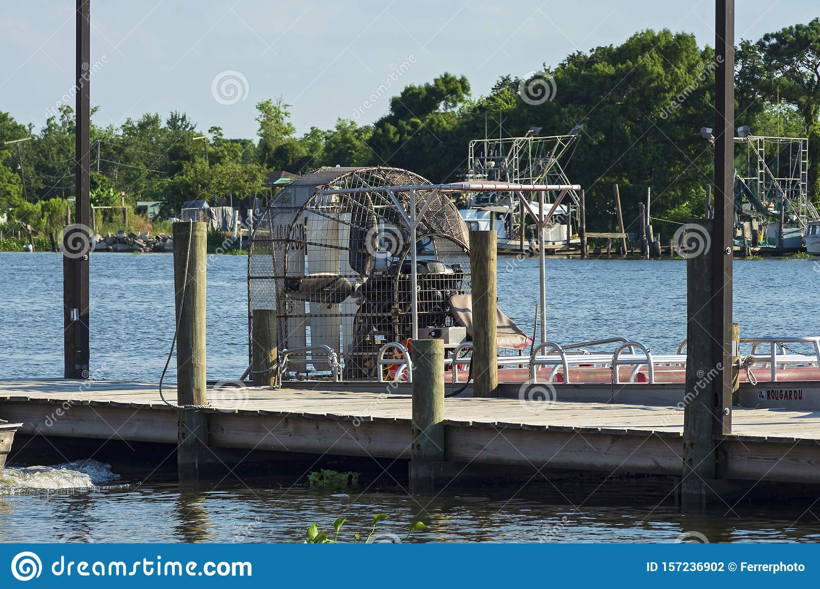 Airboat Docked at Pier in Jean Lafitte