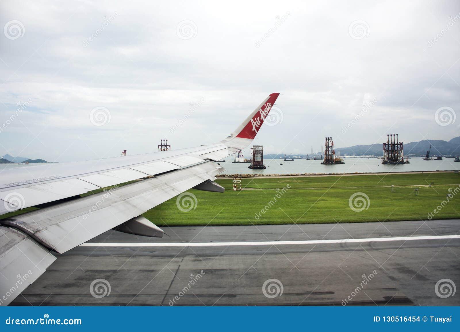 Airbus landing on runway at Hong Kong International Airport in HongKong China