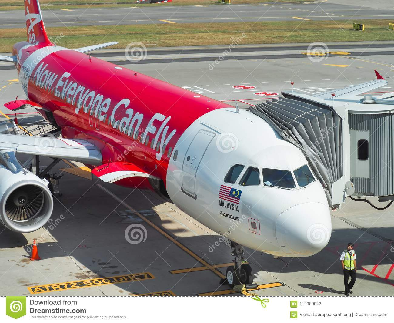 Aircraft of the Air Asia Airline waiting for passengers