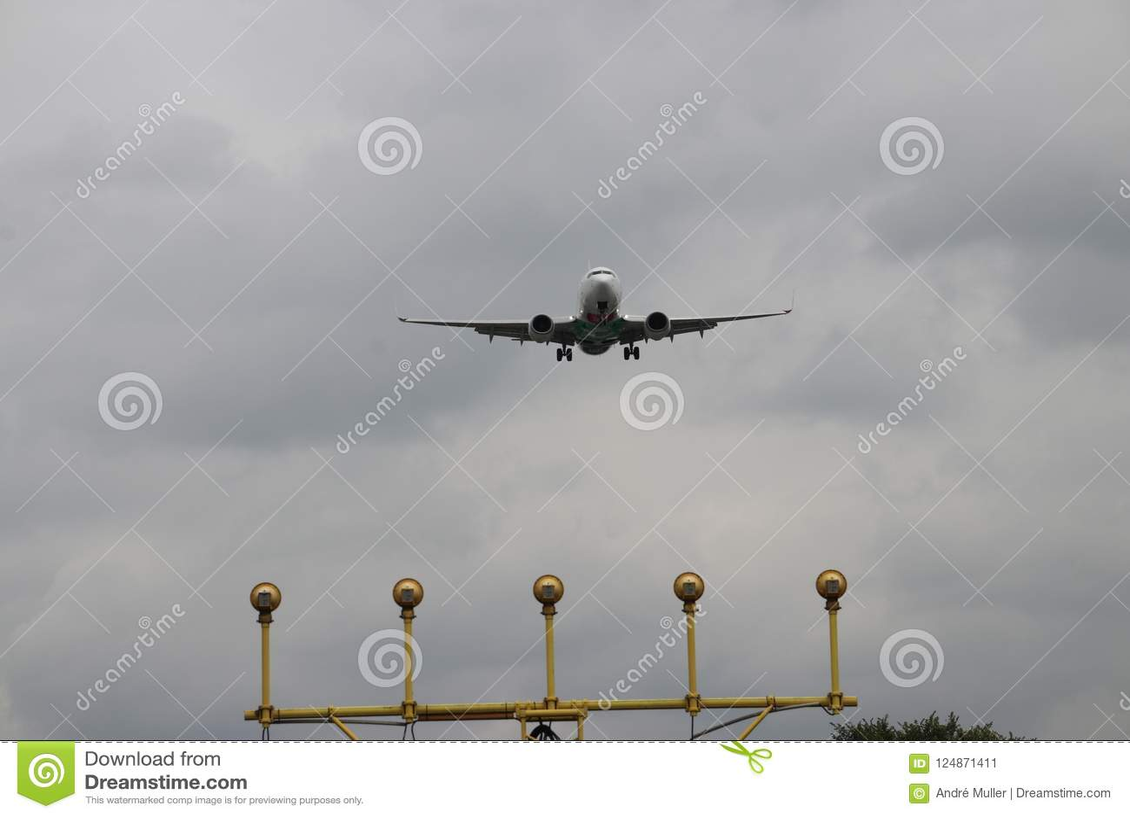 Aircraft Is Approachibg The Landing Strip Above The Landing Lights