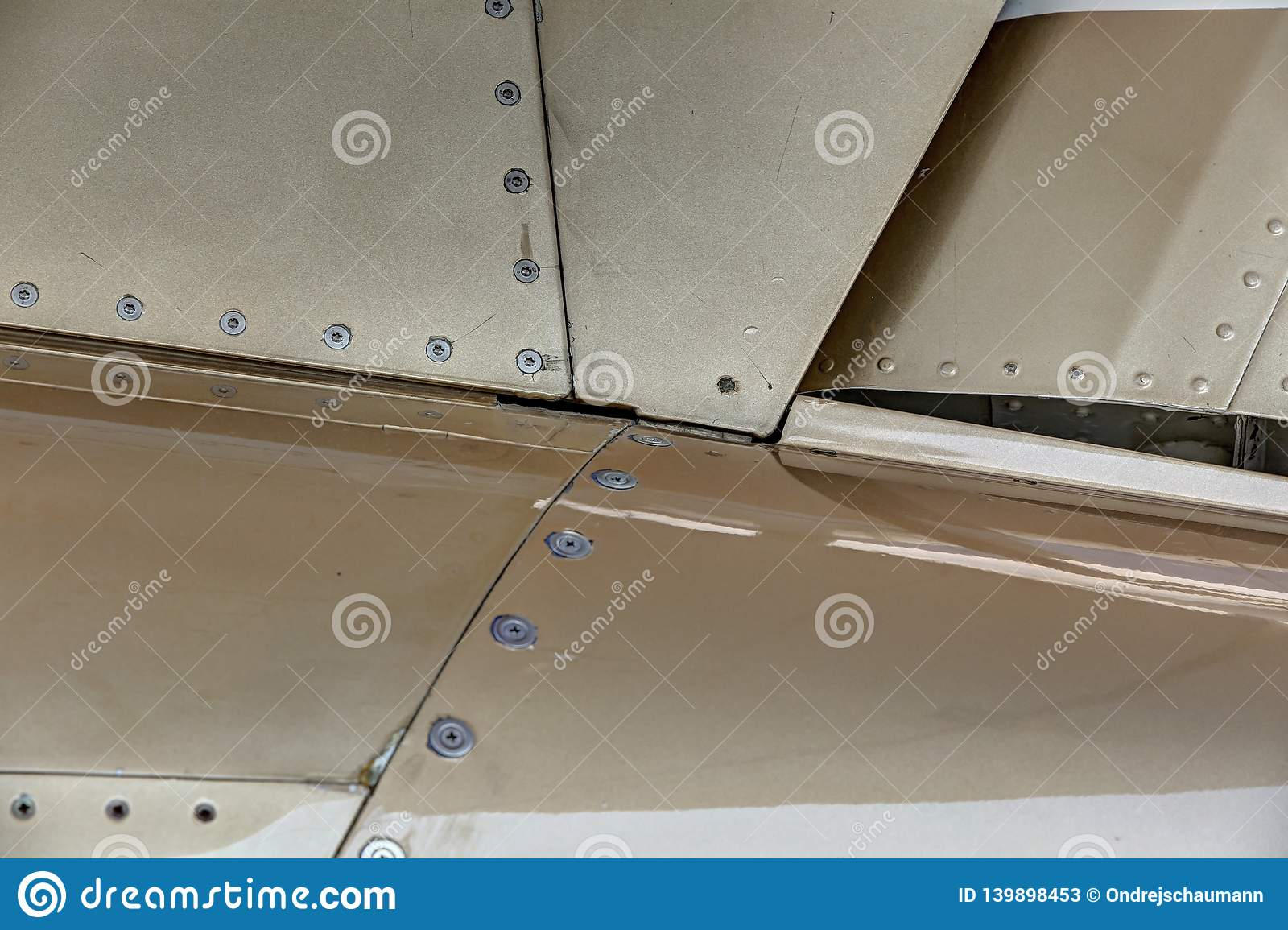 Aircraft Body Panels Detail With Golden Plates Stock Image