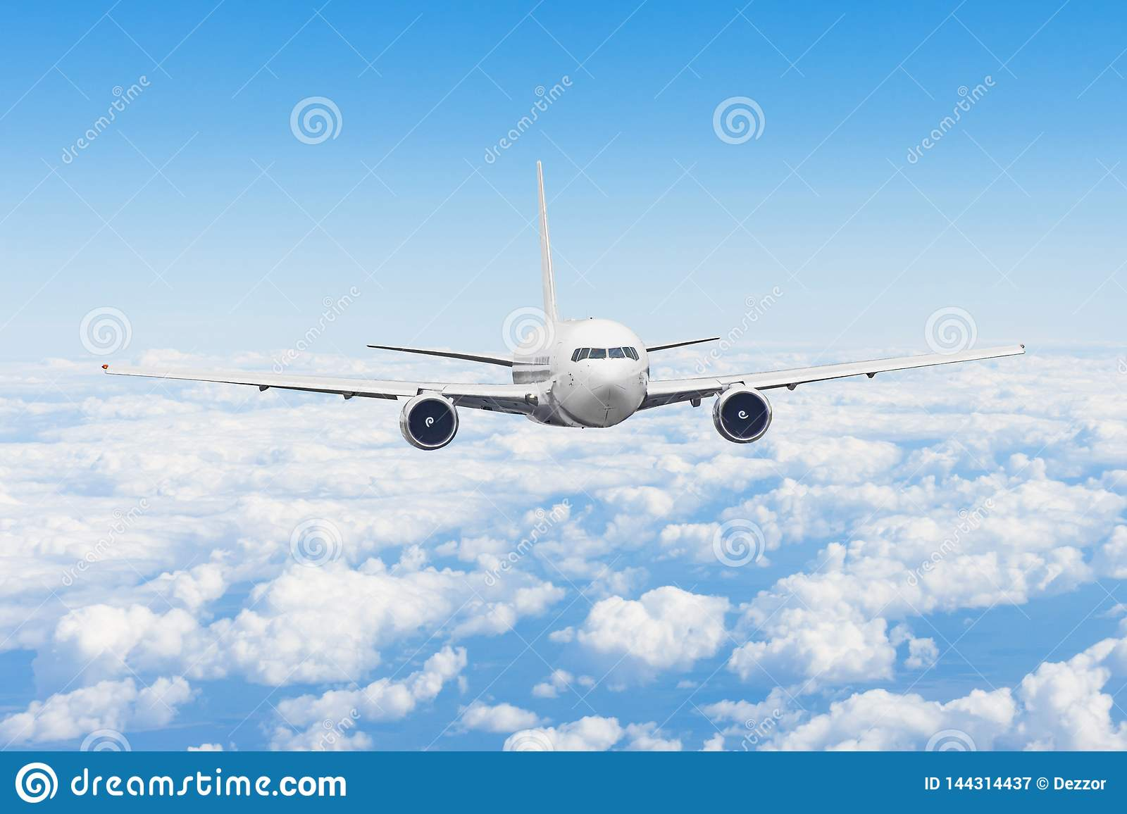Aircraft fly high in the sky above the summer clouds