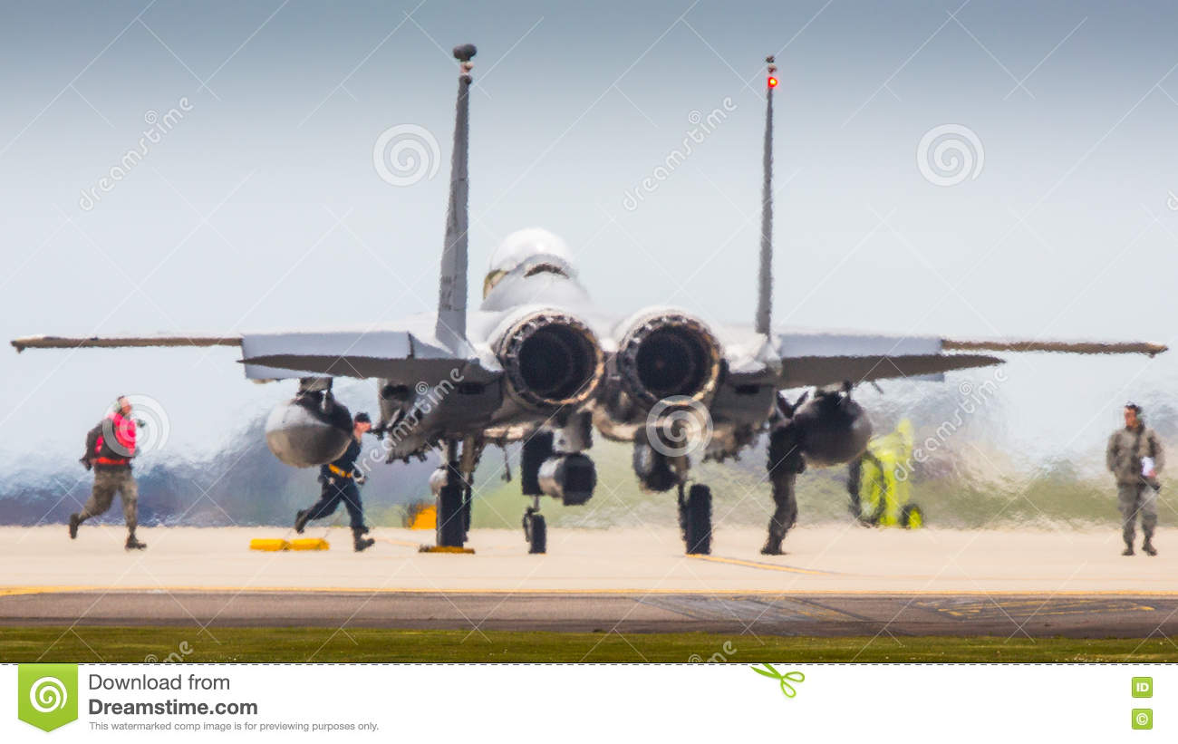 Aircrew arming F15 fighter jet