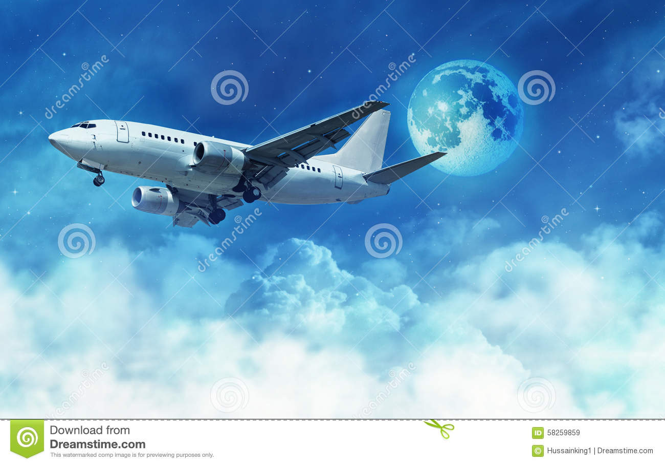 Airplane Above The Clouds Stock Photo - Image: 58259859