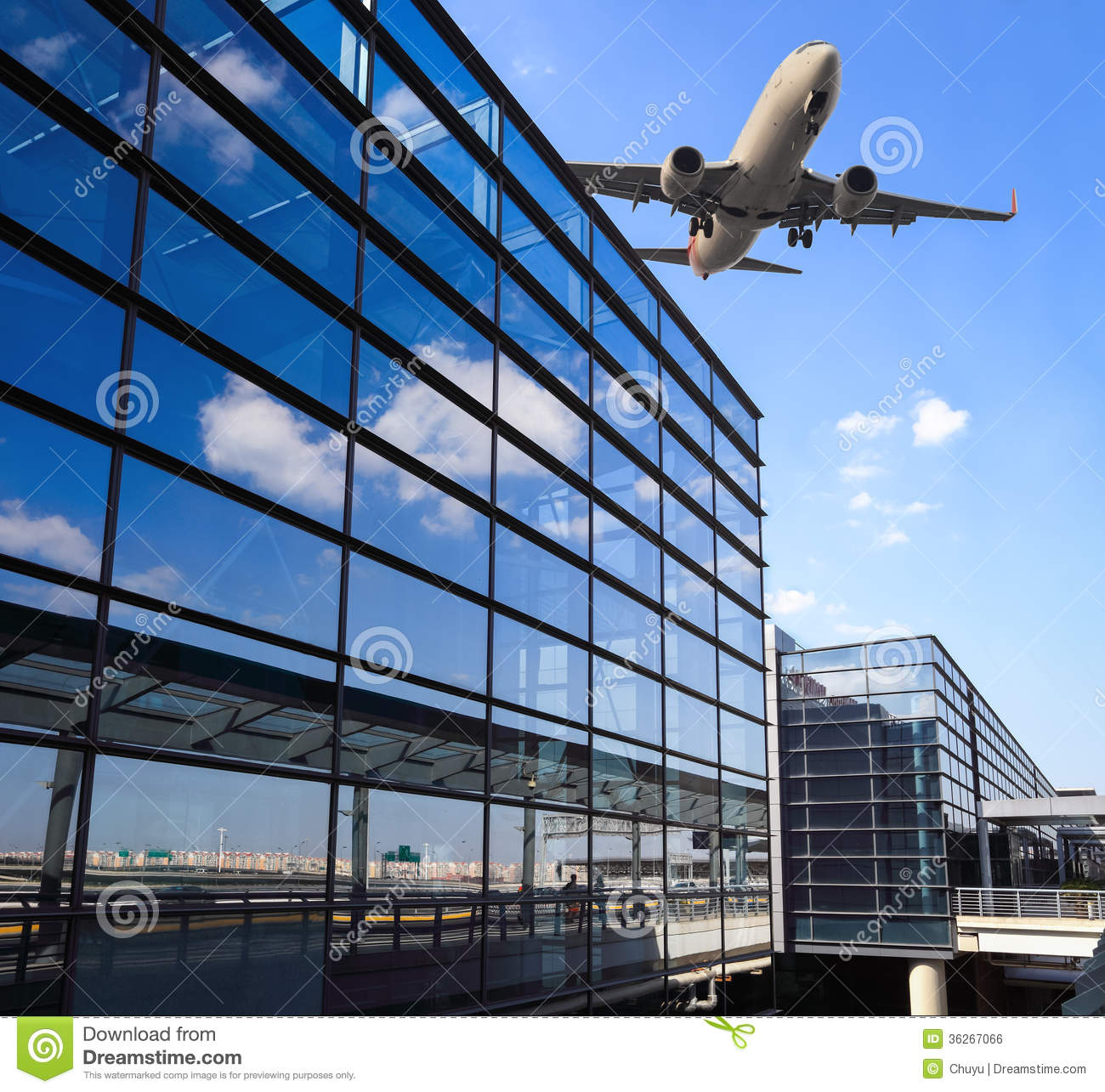 Airplane And Airport Terminal Building Royalty Free Stock