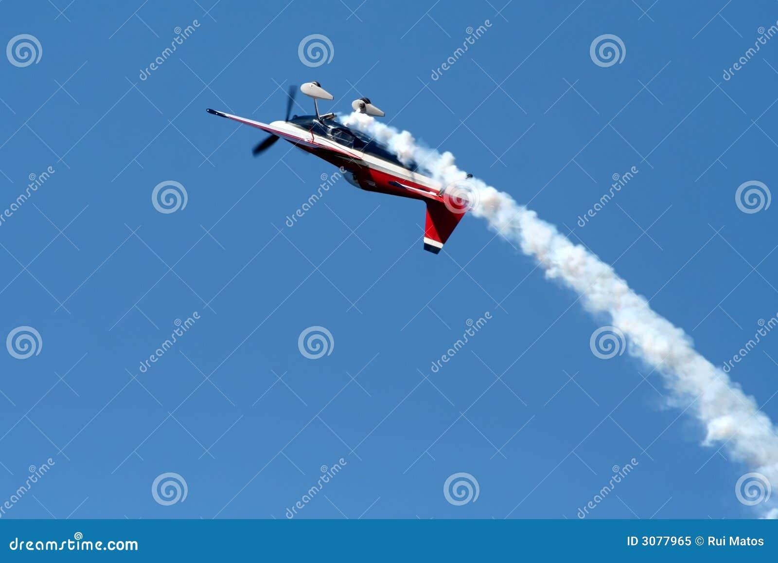 Airplane in airshow maneuvers
