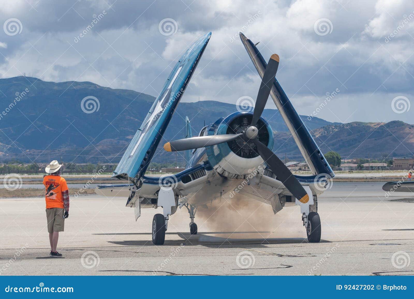 Airplane dropping smoke, during start on display