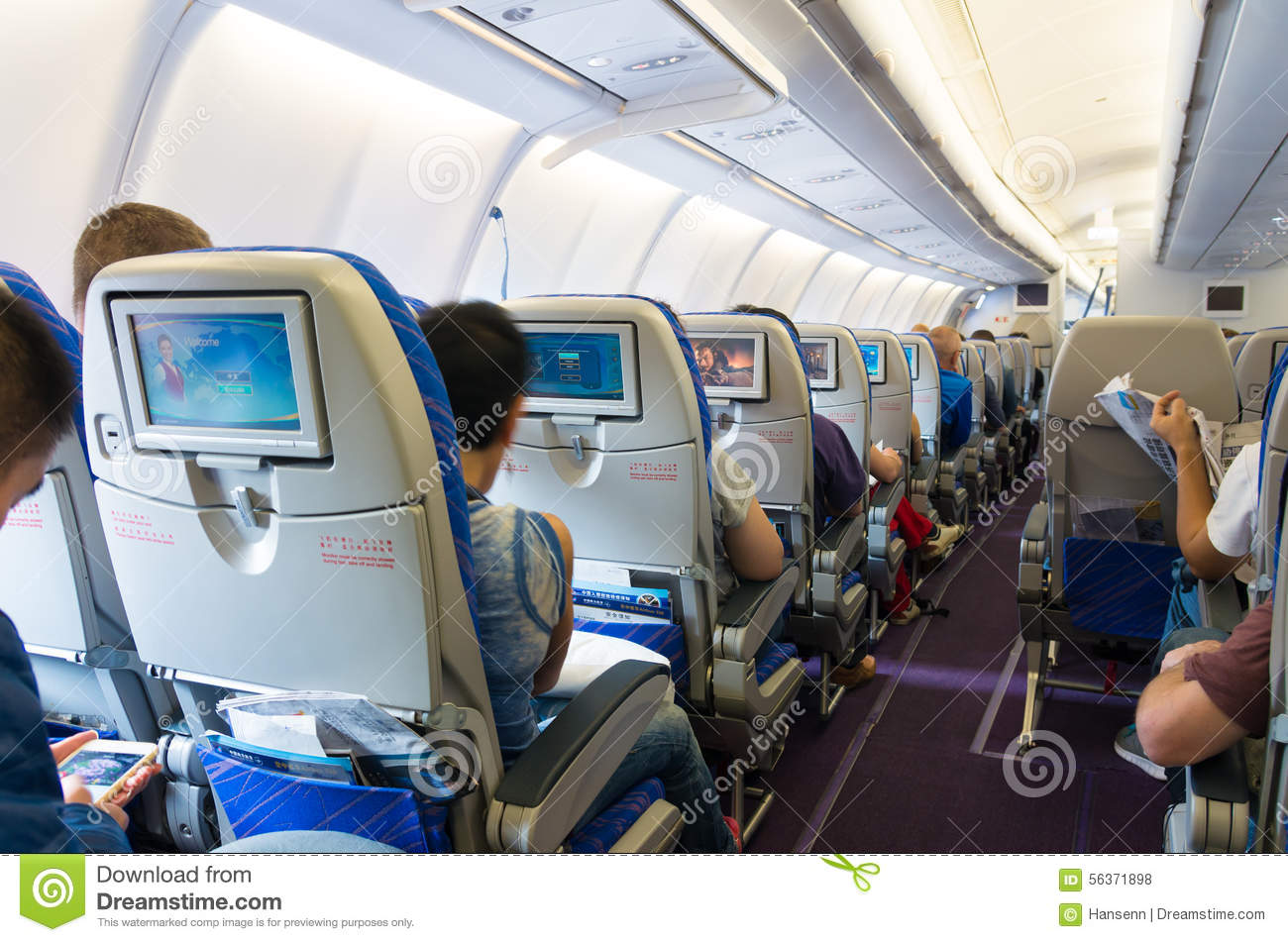 Airplane interior editorial stock photo image 56371898 for Avion jetairfly interieur