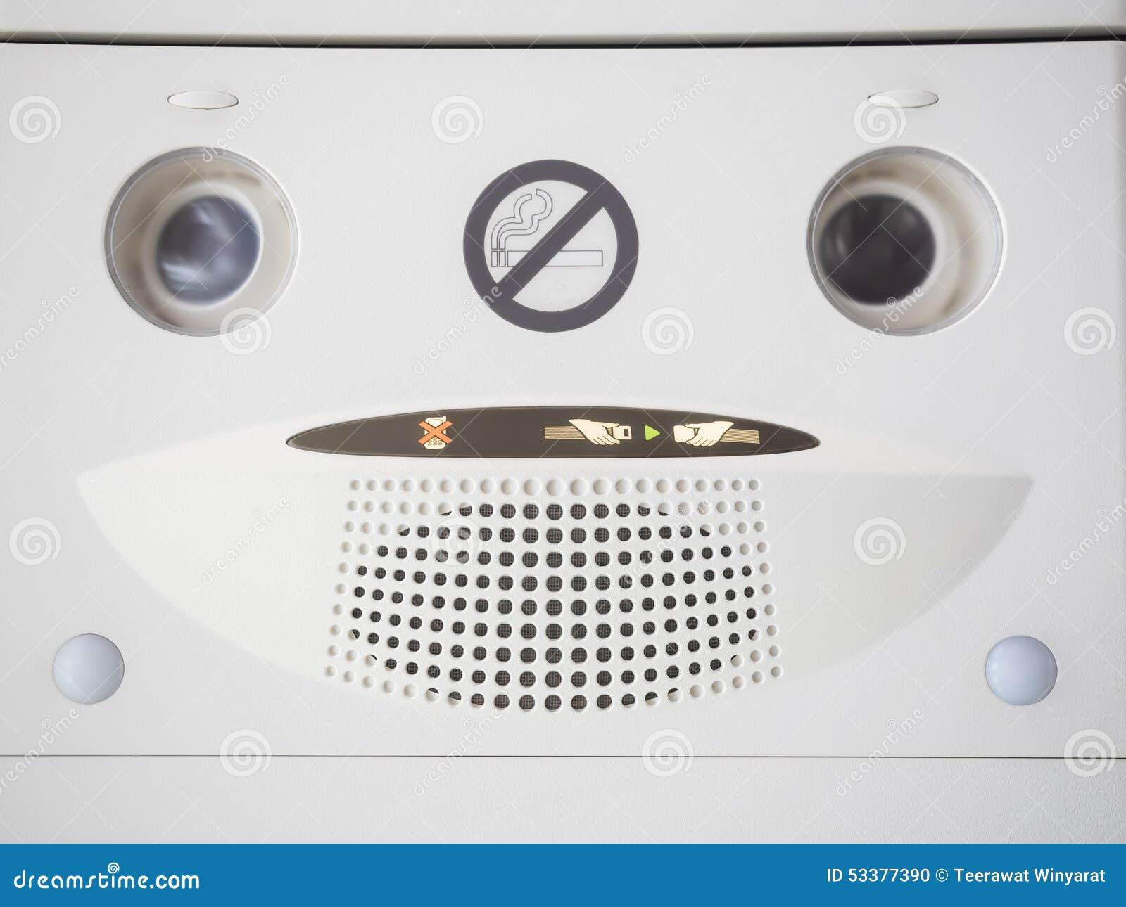 Airplane Interior No Smoking Sign And Safety Symbol Stock Photo