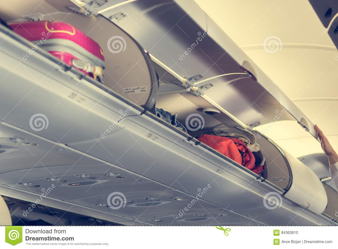 Airplane Interior With Overhead Luggage Compartment. Stock