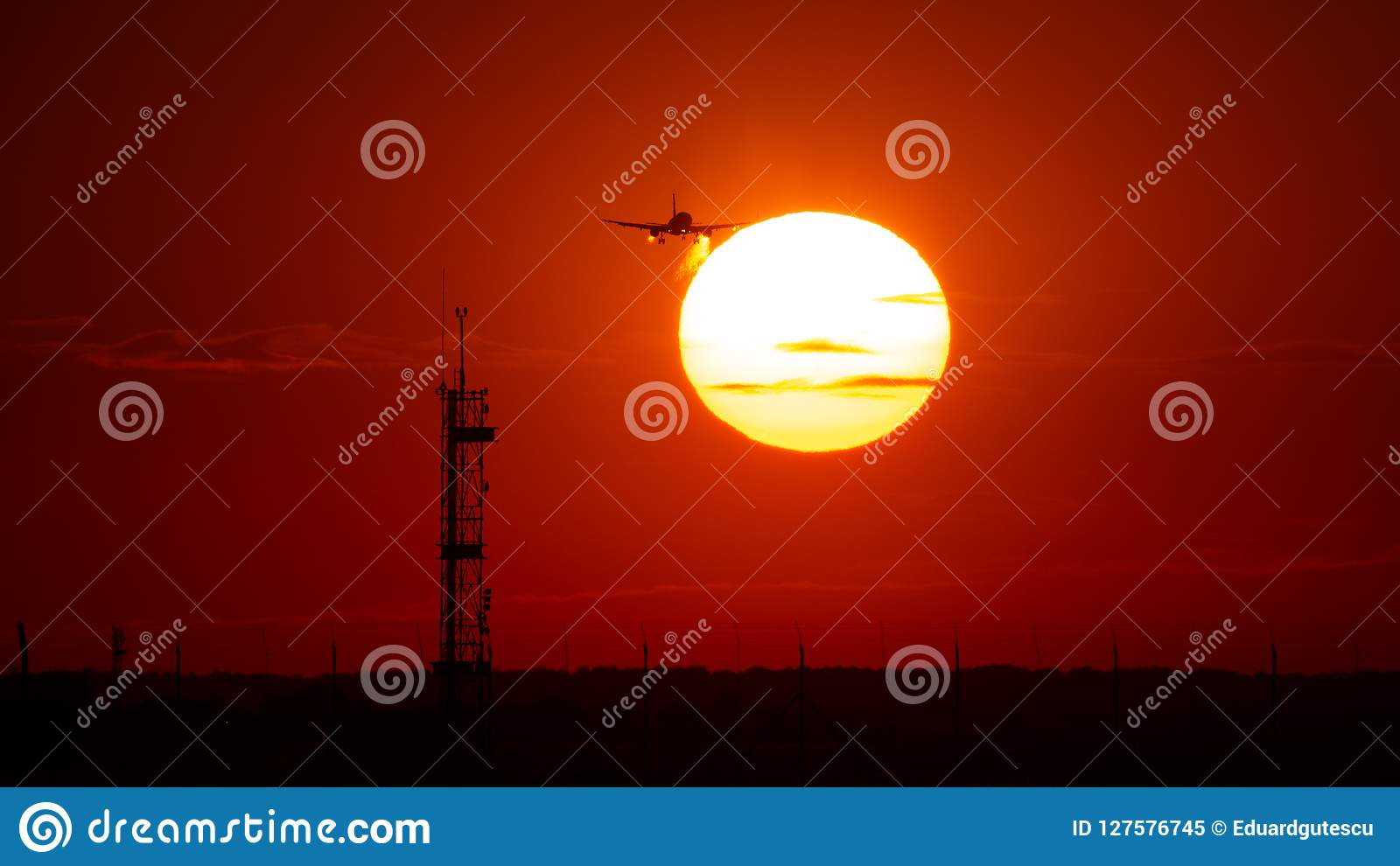 Airplane landing or takeoff in the sunset with red sky in Bucharest international airport , Plain spotting