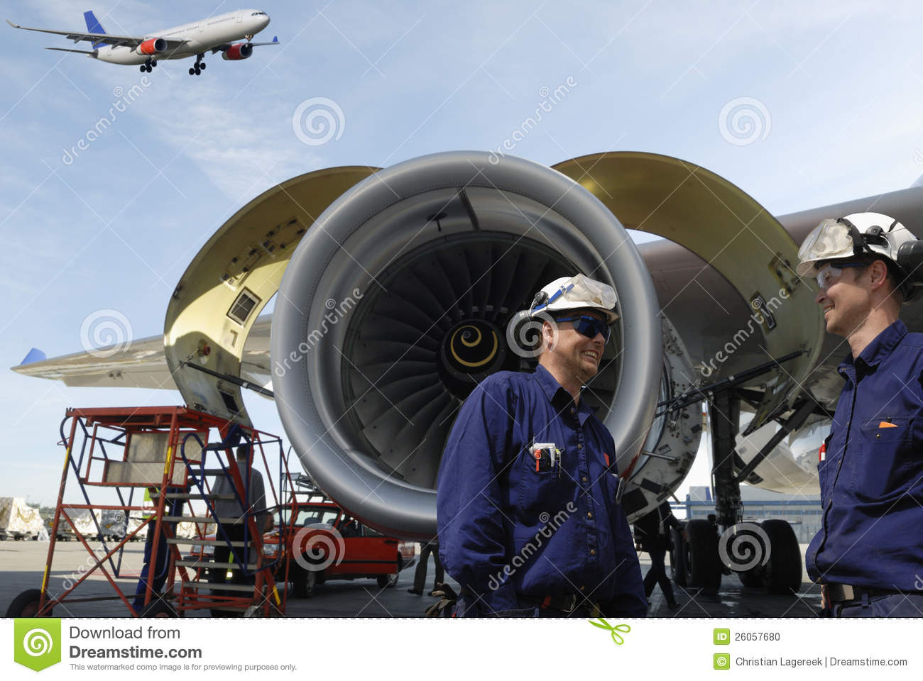 two aircarft mechanics engineers large jet engines in background