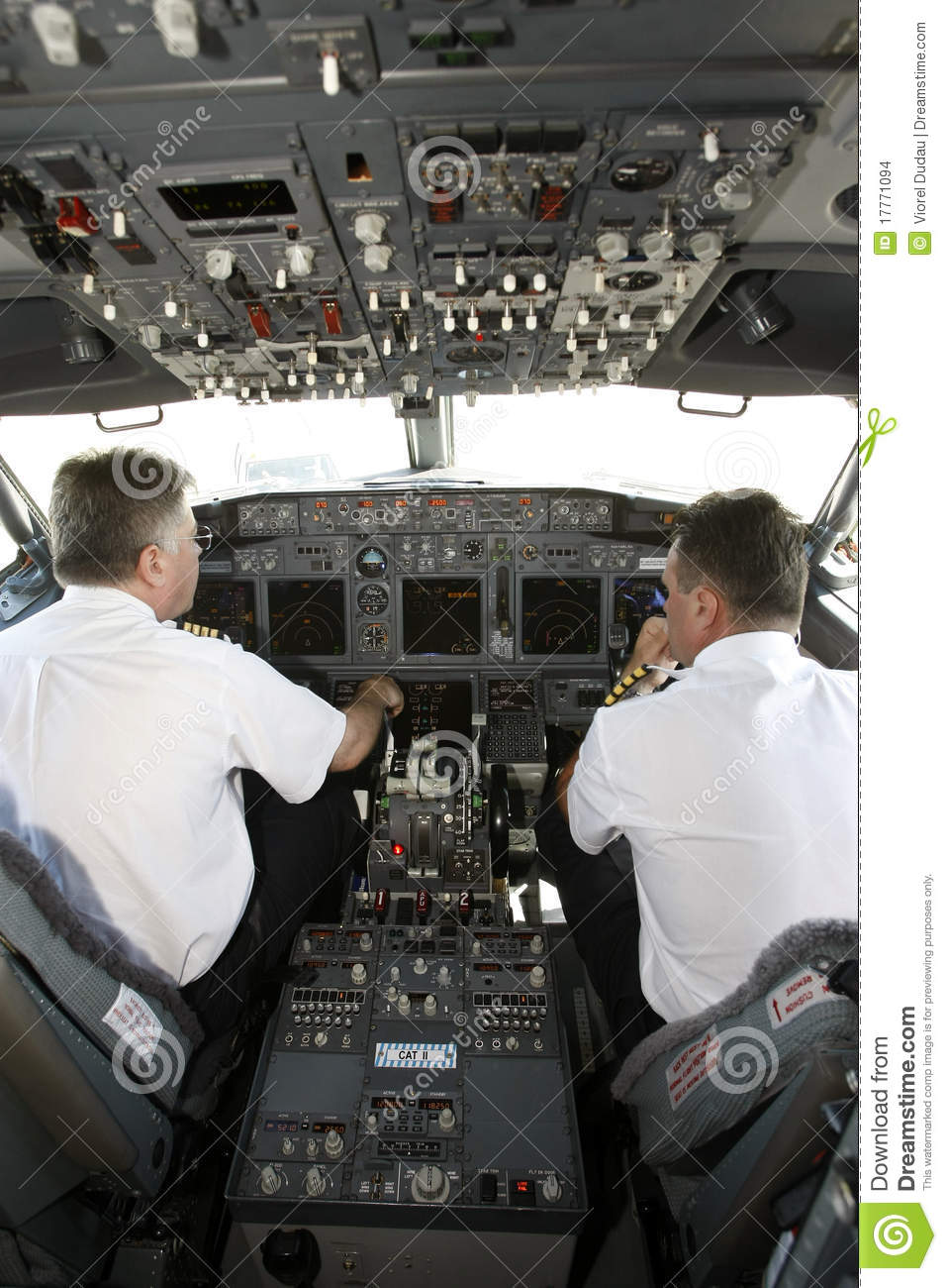 Airplane Pilots In Cockpit Preparing To Takeoff Editorial Stock