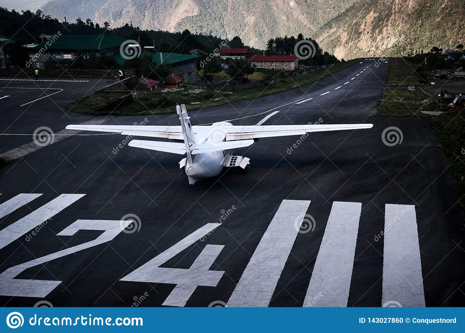 Airplane staying on the airfield of Lukla