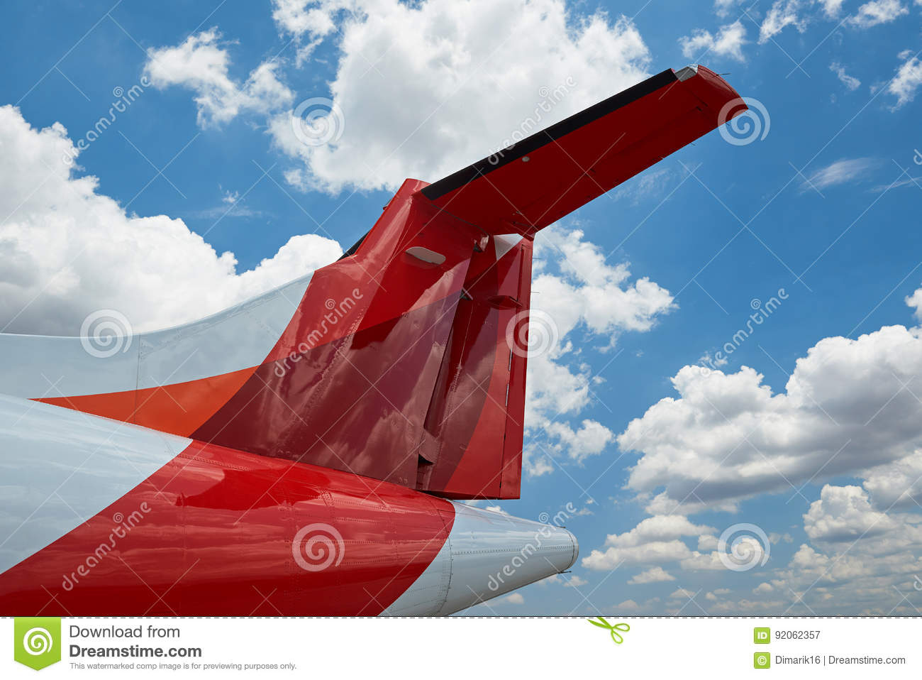 Airplane tail on bly sky background